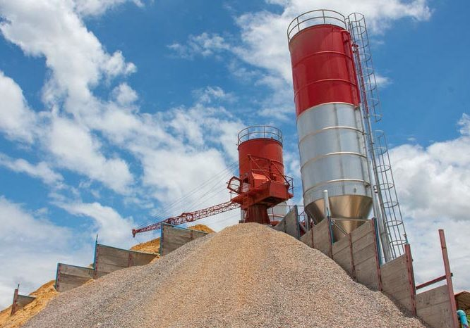 concrete batching plant, heap of sand and gravel, cement material stationary