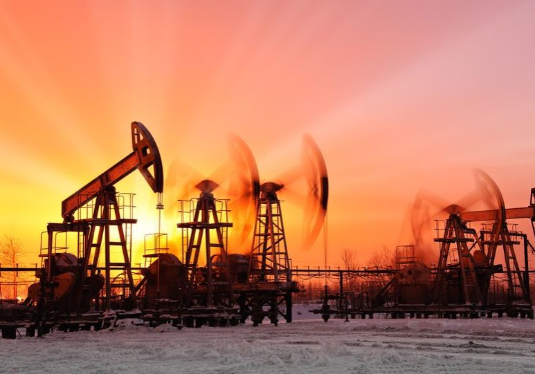 18410758 - oil pumps at sunset sky background